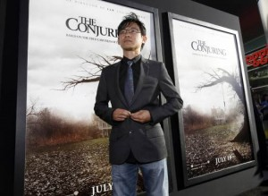 """Wan poses at the premiere of """"The Conjuring"""" at the Cinerama Dome in Los Angeles"""